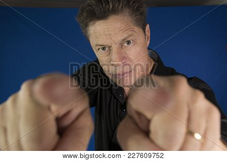 Man Looking Directly At You With His Fingers And Pointing To You