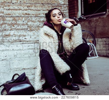 Young Pretty Stylish Teenage Girl Outside On City Street Fancy Fashion Dressed Drinking Milk Shake,