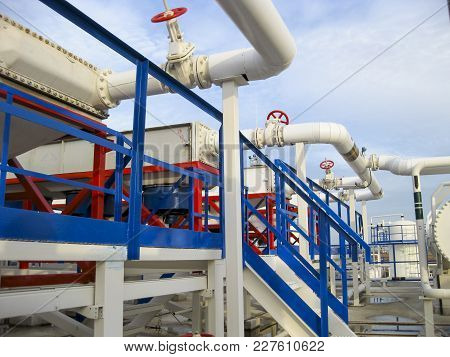 Pipes Over Gasoline Air Coolers. Oil Refinery. Equipment For Primary Oil Refining.