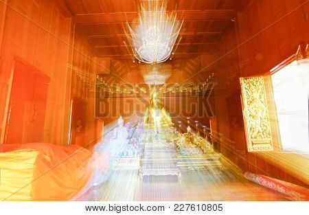 Buddhist Abstract Zoom Blur Ethereal Effect Inside Wooden Buddhist Temple With Large Golden Buddha W
