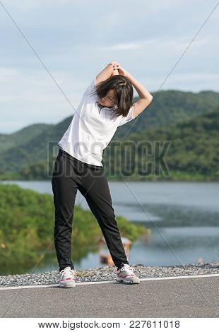 Woman Short Hair Doing Exercising Outdoor