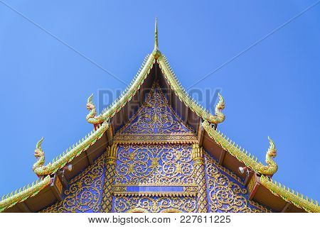 Ornate Buddhist Pagoda Facade And Gable In Gold And Blue.
