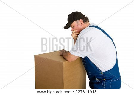 Thoughful Worker Standing Over Cardboard Box Isolated Against White Background