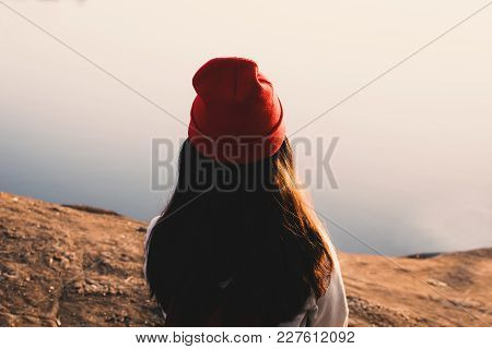 Happy Asian Woman Sitting On Rock In Nature , Relax Time On Holiday Concept Travel,selective And Sof