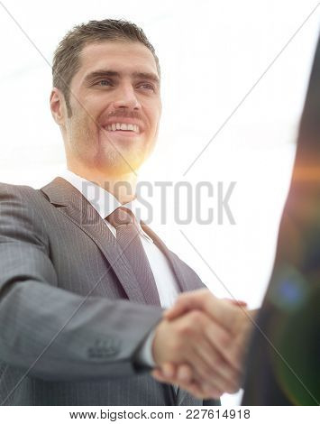 closeup .businessman shaking hands with a business partner.