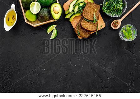 Breakfast For Safety Weight Loss. Avocado Toast With Rye Bread, Lime, Olive Oil And Greens On Black