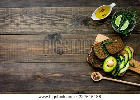 Breakfast For Safety Weight Loss. Avocado Toast With Rye Bread, Lime, Olive Oil And Greens On Dark W