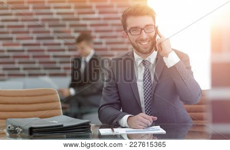 financial Manager sitting at his working place