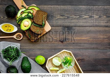 Idea For A Healthy And Nutritious Breakfast. Avocado Toast With Rye Bread, Lime, Olive Oil And Green