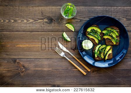 Idea For A Healthy And Nutritious Breakfast. Plate With Avocado Toast With Wholegrain Bread On Dark