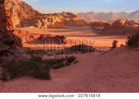 Red Mountains Of The Canyon Of Wadi Rum Desert In Jordan. Wadi Rum Also Known As The Valley Of The M