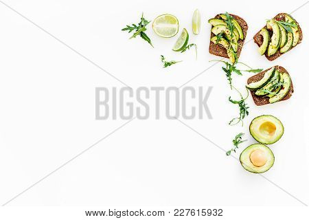 Snacks With Avocado. Avocado Toast With Rye Bread On White Background Top View.