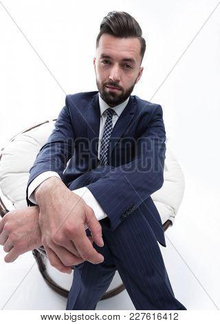 successful businessman sitting in a chair.