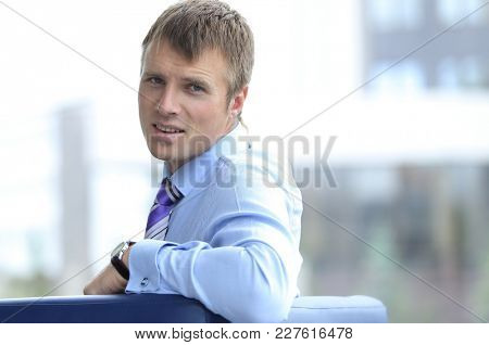 Confident businessman looking at camera, rear view