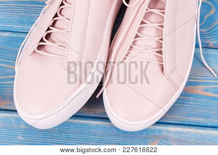 Pair Of Pink Leather Shoes For Woman Lying On Old Blue Boards