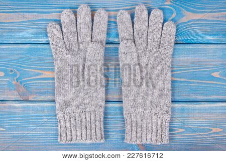 Pair Of Woolen Gloves For Woman On Old Blue Boards, Womanly Accessories For Autumn Or Winter