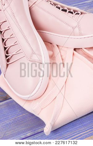 Womanly Clothing And Accessories On Old Boards, Pink Leather Shoes And Sweatshirt