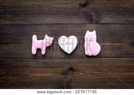 Valentine's Day Candy. Heart Shaped Cookie With Lettering Love And Kitty On Dark Wooden Background T