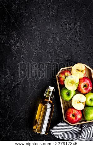 Bottle Of Fresh Cider Near Autumn Apples. Black Background Top View.