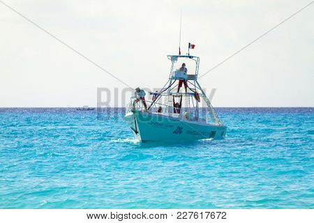 PLAYA DEL CARMEN, MEXICO - JULY 13, 2011: Unidentified people on the speed boat at Caribbean Sea of Mexico. Playa del Carmen area is very popular tourist destination with the most beautiful beaches.