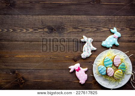 Easter Bunny And Easter Eggs Cookies. Easter Symbols And Traditions. Dark Wooden Background Top View