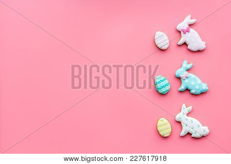 Sweets, Pastry For Easter Table. Easter Eggs And Easter Bunny Concept. Pink Background Top View.