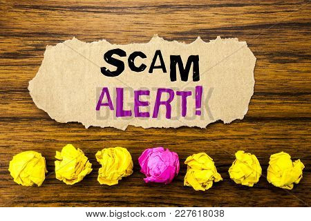 Handwriting Text   Scam Alert. Concept For Fraud Warning Written On Sticky Paper Reminder, Wooden Ba