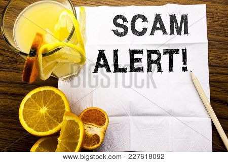 Conceptual Text Caption Showing Scam Alert. Concept For Fraud Warning Written On Tissue Paper On Woo