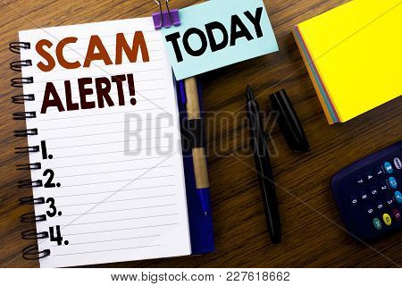 Word, Writing Scam Alert. Business Concept For Fraud Warning Written On Book Note Paper On Wooden Ba