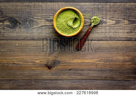 Japanese Traditional Product. Matcha Green Tea In Bowl On Dark Wooden Background Top View.