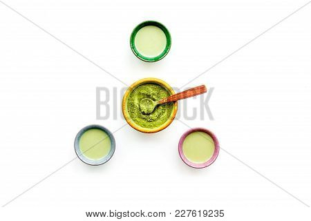 Brew Matcha Tea. Bowl With Powder And Cups With Beverage On White Background Top View.