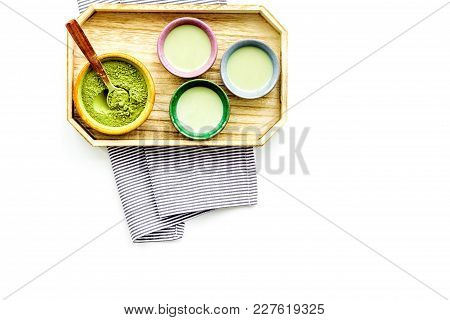 Japanise Tea Ceremony With Matcha Tea. Bowl With Powder And Cups With Beverage On Tablecloth On Whit