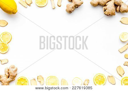 Ingredient For Warming Tea. Whole And Sliced Ginger Roots, Lemon On White Background Top View.