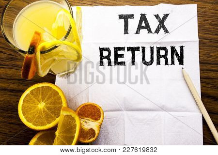 Conceptual Text Caption Showing Tax Return. Concept For Taxation Refund Written On Tissue Paper On W