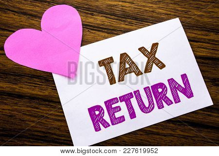 Conceptual Hand Writing Text Showing Tax Return. Concept For Taxation Refund Written On Sticky Note