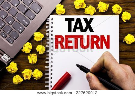 Conceptual Hand Writing Text Caption Tax Return. Business Concept For Taxation Refund Written On Tab