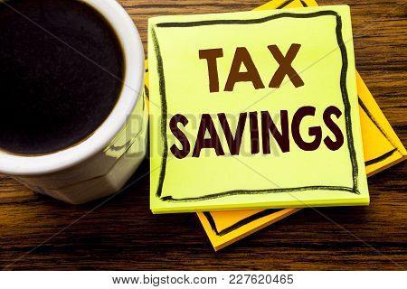 Handwritten Text Showing Tex Savings . Business Concept For Tax Savings Extra Money Refund Written O
