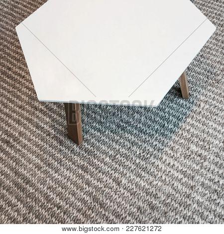 Modern White Table On Gray Knitted Rug. Scandinavian Design.