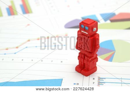 Robot Or Artificial Intelligence And Graphs Are Written Documents On White Background. Concept Of Ar