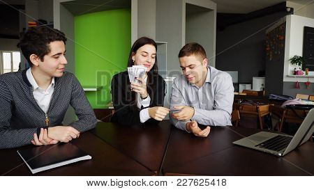 Happy Business Partners Are Happy With Success And Earned Bills