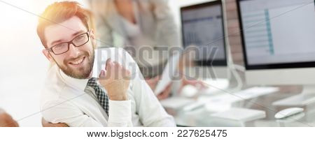 experienced programmer sitting in front of the monitor.
