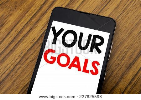 Word, Writing Handwriting Your Golas. Business Concept For Goal Achievement Written On Mobile Phone,