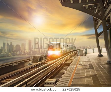 Sky Trains And Mass Transportation Station With Modern Building In City Background