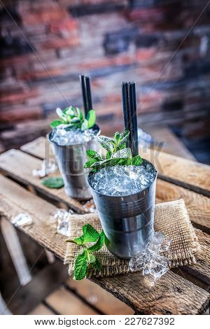 Mint Julep Cocktail Alcoholic Drink On Wooden Board In Pub Or Restaurant