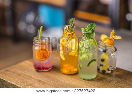 Lemonades. Lemonades With Fresh Tropical Fruit And Cucumber On Bar Counter In Pub Or Restaurant