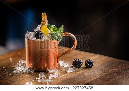 Moscow Mule Cocktail Alcoholic Drink On Bar Counter In Pub Or Restaurant.