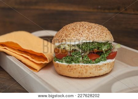 Hamburger Homemade, In Wooden Box, With Fresh Tomatoe, Letuce, Chicken Meat, On Rustic Wooden Backgr