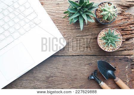 Computer Laptop On Gardening Desk, Grunge Wooden Desk, Hobby And Lifestyle Concept
