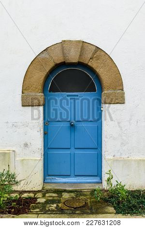 Old blue wooden door in Brittany, France