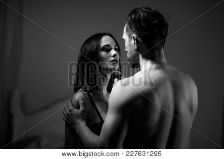 Two Belovers Standing In Lingerie. Looking At Each Other With Passion.